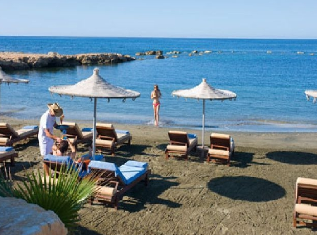 Sandy beach with umbrellas and sunbeds photo